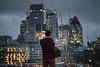 See The City Lights (Sean Batten) Tags: london england uk cityoflondon person city urban nikon d800 70200 lights dusk skyline cityscape thegherkin cranes