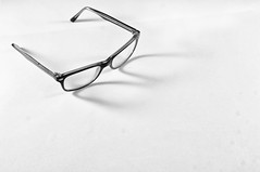 making a spectacle (kevin towler) Tags: glasses pair spectacle stilllife single blackandwhite black white negative space negativespace