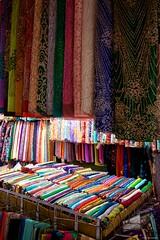 IMGP7861 Colored fabrics at Ben Thanh Market (Claudio e Lucia Images around the world) Tags: street hochiminh saigon vietnam pentax streetmarket vendor pentaxk3ii sigma sigma1020 insegna benthanhmarket fabric tissues coloredtissues