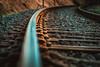 in der Kurve (Timo Nennen) Tags: schienen zug eisenbahn locomotive eisenbahnschienen kurve macro makro lines linien schrauben steine stones screw eisen steel rust rost orangeteal