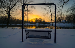 Sunrise Swing (tquist24) Tags: bristol congdonpark indiana nikon nikond5300 stjosephriver cold geotagged ice morning park reflection reflections river silhouette silhouettes sky snow sunrise sunset tree trees water winter unitedstates