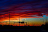 twilight time (mariola aga) Tags: evening sunset twilight sky clouds contrails road highway lamps signs silhouettes dusk
