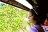 Little girl looking through window (Olivier Roche) Tags: looking girl window enfance portrait little asie srilanka enfant through profil