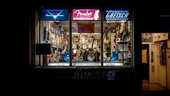 Regent Sounds (Sean Batten) Tags: london england uk nikon d800 50mm night streetphotography street shop people dark window city urban guitar lights music westend denmarkstreet