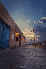 "Souq Waqif ""Sun Rays"" (Nabeel Iqbal) Tags: doha qatar al wakra wakrah souq waqif wakif sunrise sun clouds sunrays rays colors ocean bazaar market photography architecture canon camera 6d 1740mm landscape cityscape"