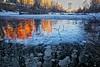 Methane Calgary landscape 2017 (John Andersen (JPAndersen images)) Tags: bubbles calgary elbowriver house lights methane pond reflections skyline sunset winter