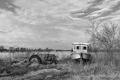 At the Edge of the Field (Working Image Photography) Tags: tractor boat clouds abandoned
