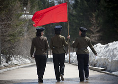 North Korean students with a red flag walking on the steps of the nation's heroes in mount Paektu, Ryanggang Province, Samjiyon, North Korea (Eric Lafforgue) Tags: adults adultsonly asia cap communism dictatorship dprk endoctrinement female flag fulllength horizontal humanbeing indoctrinating mountbaekdu mountpaektu nkorea8714 northkorea people pilgrimage pilgrims rearview red redflag ryanggangprovince samjiyon snow students threepeople uniform woman women womenonly 北朝鮮 북한 朝鮮民主主義人民共和国 조선 coreadelnorte coréedunord coréiadonorte coreiadonorte 조선민주주의인민공화국 เกาหลีเหนือ קוריאההצפונית koreapółnocna koreautara kuzeykore nordkorea північнакорея севернакореја севернакорея severníkorea βόρειακορέα