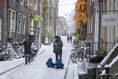 The Jordaan district in the winter where daddy's meet (B℮n) Tags: amsterdam snow covered bikes bycicles holland netherlands canals winter cold wester church jordaan street anne frank house dutch people scooter gezellig cafés snowy snowfall atmosphere colorful windows walk walking bike cozy boat light rembrandt corner water canal weather cool sunset file celcius mokum pakhuis grachtengordel unesco world heritage sled sleding slee seagulls meeuwen bycicle 1°c shadows sneeuw slippery glad flakes handheld wind nieuweleliestraat tweedeleliedwarsstraat café denieuwelelie heineken twins tweeling father 100faves topf100
