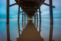 Blue Intensifies (ashercurri) Tags: oceanana pier ocean water coast nc north carolina atlantic beach reflection blue