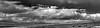 a black-white look toward Jemez Mountains (johngpt) Tags: wclwideconversionlens viewtowardsantaanamesa viewtowardjemezmountains fujifilmfinepixx100 fromsandiacasinoparkingstructure clouds sliderssunday hss