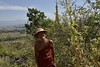 DSC_7346 (Kent MacElwee) Tags: guard myanmar burma sea asia southeastasia lake freshwaterlake inlelake shweindeinpagoda ruins buddhist buddhism ancient historic temple pagoda shanstate nyaungshwe indeinvillage monk buddhistmonk hat