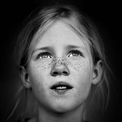 Meike (serious look) 2 (PascallacsaP) Tags: portrait girl eyes blackandwhite bw captureonepro monochrome daughter young freckles noir