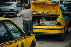 Special Luggage (explored 2018/02/18) (toletoletole (www.levold.de/photosphere)) Tags: fuji fujixpro2 isfahan esfahan street people portrait porträt taxi child kofferraum kind trunk