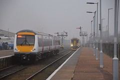 Running in reduced 2 car formation, 170 202 departs from Lowestoft, with the 07.27 service to Ipswich, as 156 422 arrives with the 06.45 service from Norwich. 21 02 2018 (pnb511) Tags: diesel class170 class156 sprinter turbostar wherrylines track train trains station platform semaphore signals post dolly