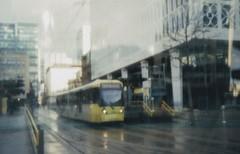 Manchester (631) (benmet47) Tags: tram transport urban city metrolink bombardier m5000 bombardierm5000 film lomo lomography holga135pc pinhole canoscan9000f