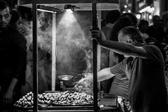 the craving / smoke on the table (Özgür Gürgey) Tags: 2014 50mm bw beyoğlu d7100 nikon candid chestnut lowlight night smoke street istanbul grainy