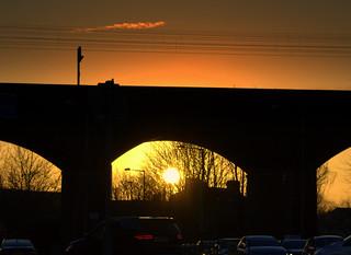 Setting sun through the arches at Preston