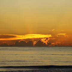SUNRISE OVER THE ATLANTIC (R. D. SMITH) Tags: squareformat sunrise ocean florida dawn atlanticocean melbourneflorida brevardcountyflorida orange sun clouds morning sky water canoneos7d