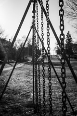 the Dead of Winter (The Wandering Cameraman) Tags: d750 nikon 50mm prime blackandwhite blackwhite chains sun swings playground middlebury middleburycollege vermont cityscape perspective depthoffield bokeh