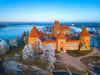 Trakai castle at winter, aerial picture (Lukjonis) Tags: 500px park landscape sunrise lake frozen city winter water nature island blue europe tower building background beautiful view aerial snow history photo evening town fountain castle top ice lay baltic old ancient frost picture photography landmark gothic lithuania medieval states historical eastern catholic union flat above churches residential european steeple trakai drone roman lithuanian townscape representative galve almudaina palace vytautas croatian culture marienberg fortress