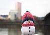 Frosty Posing Cityscape (Orbmiser) Tags: mzuikoed1240mmf28pro 43rds em1 mirrorless olympus ore portland m43rds frosty snowman stuffedtoy willametteriver cityscape