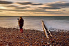 Photographer in bobble hat (Geoff Henson) Tags: longexposure photographer camera tripod sea breakwater water beach sky clouds person 1000v40f