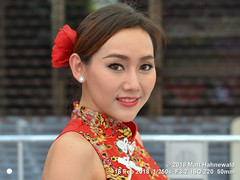 2018-02a Bangkok Chinatown (16b) (Matt Hahnewald) Tags: matthahnewaldphotography facingtheworld head face makeup bigeyes eyelashes beautifuleyes almondshapedeyes mouth teeth lips lipstick facialexpression eyecontact dress chinesedress cheongsam hair hairstyle flowerinhair red fashion chinesenewyear consent rapport fun travel culture lifestyle beauty style yeowarat chinatown bangkok thailand thai oneperson female young woman photography image photo faceperception physiognomy nikond3100 nikkorafs50mmf18g primelens 50mm 4x3 horizontal street portrait closeup headshot threequarterview outdoor color posingforcamera smiling beautiful attractive sensual pretty stunning angelic captivating charming classy fabulous gorgeous photoshoot thaismile facialview