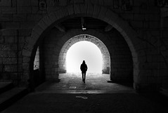 (cherco) Tags: lonely light blackandwhite blancoynegro arquitectura architecture arch city man alone repetition loner medieval france black soledad solitary monochrome