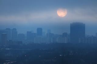 Super Blue Blood Moon on Misty Morning