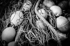 Fishing Buoys and Nets (King Grecko) Tags: bw commercialfishingnet fishingnet industry nopeople quayside rope blackandwhite boat bouy contrast dramatic fishing fishingboat nautical nets seamediterranean seascape seaside spain texture trawler