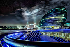 Tower Bridge and City Hall under the Stars (Jacob Surland) Tags: architecture art blue bridge building caughtinpixels city citybynight cityhall cityscape clouds coldlight colors country england fineart fineartphotography geometry greatbrittain hdr highdynamicrange jacobsurland light lightbeams lights lines london londoncityhall londontowerbridge night oldbuilding realismdigitalart scifi sciencefiction sky stars time uk unitedkingdom