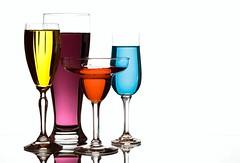 Glasses (Karen_Chappell) Tags: glass glasses white colourful colours colour color blue red yellow purple stemware product stilllife four 4 liquid