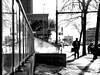 Reflecting (George Stastny. Photographer.) Tags: street streetphotography streets shadows silhouettes monochrome blackandwhite bnw bw edmonton alberta canada getolympus olympus omd