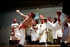 55-602 (ndpa / s. lundeen, archivist) Tags: nick dewolf nickdewolf photographbynickdewolf 1974 1970s color reel55 55 35mm film boston mass massachusetts symphonyhall stage performance catellitrinidadallstars trindadian ambakaila trinidadcarnivalballetandsteelband trinidad carnival ballet steelband dance dancing dancer dancers costume costumes costumed traditional performer performers show caribbean flag flags headband headbands women youngwomen dress dresses whitedress whitedresses headwrap headwraps man youngman shirtless sash redsash woman youngwoman