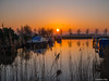 Sunset in Holland (✦ Erdinc Ulas Photography ✦) Tags: sunset holland panasonic netherlands dutch landscape colourful nederland village water reflection tree smooth boat sun focus house building farm peaceful red orange shadow dark reed dorp zonsondergang boot zon sky