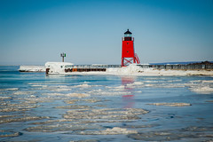 Beacon Surrounded by the Ice (T P Mann Photography) Tags: ice lake sea seascape michigan charlevoix red reflections cold winetr canon
