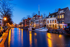 A boat @ Schiedam (Marcel Tuit | www.marceltuit.nl) Tags: bluehour canon eos holland me marceltuit mill molen nederland schiedam thenetherlands zuidholland architecture architectuur blauweuur boat bomen boot city contactmarceltuitnl dawn dusk goudenuur harbor harbour haven historie history lantaarn licht light reflecties reflections rijnmond schemering schip ship stad trees twilight water windmill wwwmarceltuitnl