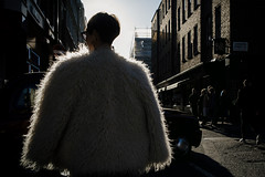 The Last Yeti 123/156 (markfly1) Tags: london england soho high contrast yeti walking abominable snowman winter walk rim lighting fashion fake fur faux coat wool long shadows white light harsh sun semi silhouette black can nikon d750 35mm manual focus lens