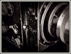 Listen to the shutter (Bob R.L. Evans) Tags: sepiatone vintagecamera 214camera focusingring arrows unusual defamiliarization pov composition symbol availablelight