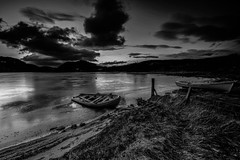 Icy Ruthven. (Gordie Broon.) Tags: icyloch boats fishing lochruthven postsunset blackwhite invernessshire scottishhighlands schottland scotland tullich croachy landscape colinas paysage dalcrombie paisaje scenery clouds ice skyreflections ecosse beach escocia fence monochrome szkocja gordiebroonphotography scenic scozia scenario lago lac grass caledonia alba meer see collines landschaft errogie sonya7rmkii ilce7rm2 sonyzeiss1635f4lens winter january 2018 geotagged