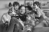 Phone Fun (jayneboo) Tags: family grandchildren fun games phone group portrait home bw mono candid smiles laughter happiness leica cl 35mm
