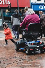 Get to the way! (garethottywill) Tags: granny child kid wheels running aid purple pink red blue short driving raining fujifilm fujinon xf50mmf2