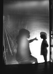 Twins behind visqueen (trois petits oiseaux) Tags: twins sisters shadow personalities kids childhood family monochrome