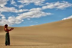 Wishes do come true (Symbiosis) Tags: desert desertlandscape deathvalley genie genieinabottle makeawish womanmakingawish sanddunes mesquitesanddunes