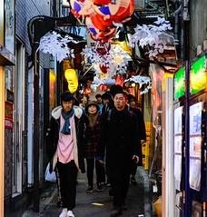 Wonder / Piss Alley Woman (thedailyjaw) Tags: japan tokyo shinkansen food japanese yakitori ramen sushi fish omeideyokocho pissalley alley streetphotography street nikon d610 winter cold wonder lanterns plastic vending machine people three rule composition pose amazement