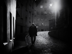 lost in thought (Sandy...J) Tags: atmosphere alone atmosphäre altstadt olympus oldtown monochrom man mood stimmung noir photography fotografie germany deutschland light licht darkness dunkelheit street streetphotography sw schwarzweis strasenfotografie stadt shadow blackwhite bw black white walking wall urban cobblestones