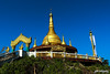 The Golden Crown (shamahzoha) Tags: golden temple beautiful bangladesh blue sky vibrant colorful colors dome tower gate design decor decorations religion nature hilltop perched high landscape amazing beautifulbangladesh travel travelogue bandarban buddha green grass earth