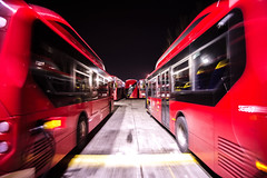 Whacky races (Paul Wrights Reserved) Tags: bus buses london londonbus londonbuses electricbus chargung parked movement motion static tfl red redbus electric nightphotography nighttime night vanishingpoint leading lines blurmotion blur