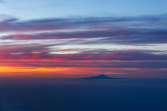 Mount Taranaki (Daniel Talbot) Tags: aerialphotography mountegmont mounttaranaki mtegmont mttaranaki newzealand northisland taranaki tasmansea teikaamāui autumn colours dusk evening nightfall ocean oceania oceans orange purple sea seas season seasons sunset sundown twilight